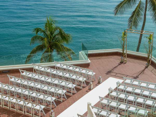 Rooftop wedding with an ocean view.